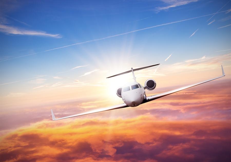 bigstock-Private-jet-plane-flying-above-169210931.jpg