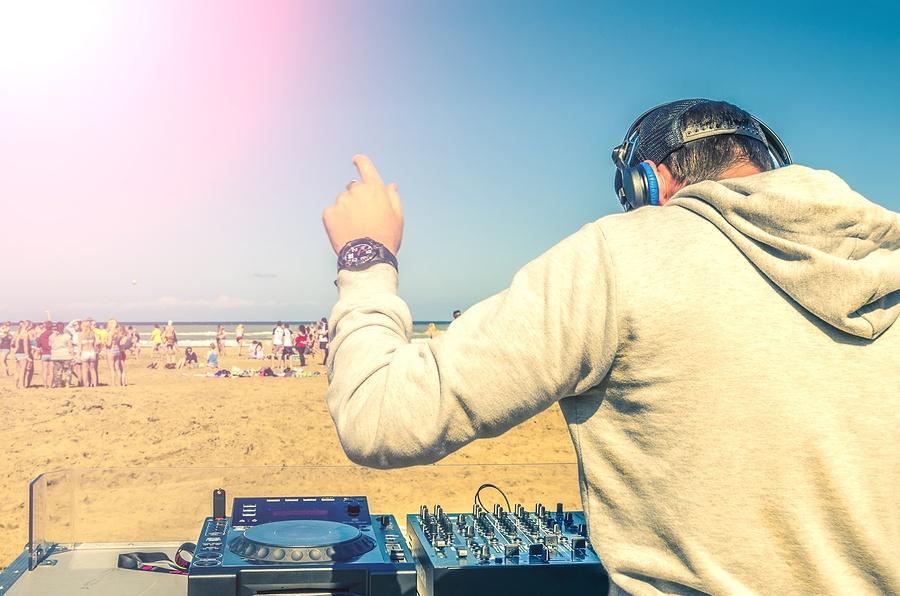 bigstock-Dee-Jay-Mixing-At-Beach-Party-64190254.jpg